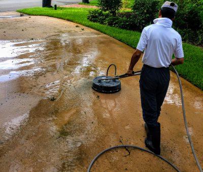 Employee Professional Pressure Washing Driveway